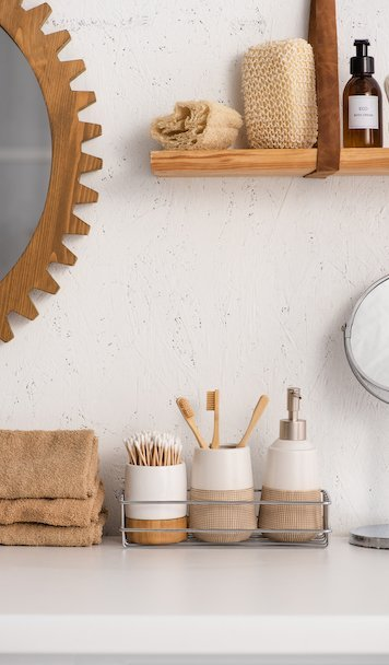 Bathroom With Eco Bamboo Objects And Cosmetic Products on Shelves, Zero Waste Concept